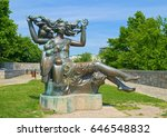 Small photo of BRATISLAVA, SLOVAKIA - MAY 11, 2017: Bosorka (Slovakian witch) - allegoric bronze sculpture, created in 1989 by Tibor Bartfay, located on the castle hill next to Bratislava Castle. Selective focus.
