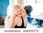 happy young mother swimming... | Shutterstock . vector #646554772
