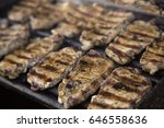 steaks on barbecue grill | Shutterstock . vector #646558636