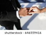 groom wears ring on bride's... | Shutterstock . vector #646559416