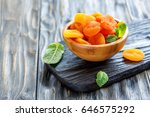 bowl of dried apricots on the... | Shutterstock . vector #646575292