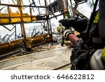 firefighter extinguishes fire | Shutterstock . vector #646622812