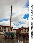 Small photo of LHASA,TIBET/CHINA-MAY 11: Jokhang Temple and prayers on May 11,2017 in Lhasa, Tibet, China. The temple is located on Barkhor Square in Lhasa, is Tibet first Buddhist temple.