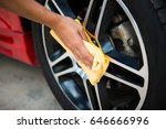 man worker cleaning car's alloy ... | Shutterstock . vector #646666996