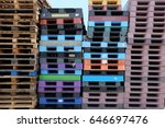 Stacked Wooden Pallets At A...