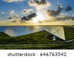 Stock photo solar panels at sunrise with cloudy sky in normandy france solar energy modern technology of 646763542