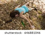Small photo of Unconscious drunken man sleeping in the park