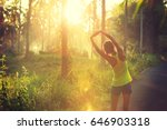 young female runner stretching... | Shutterstock . vector #646903318