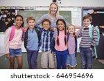 happy teacher standing with... | Shutterstock . vector #646954696