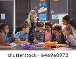 teacher helping schoolgirl with ... | Shutterstock . vector #646960972