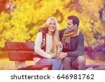 happy young couple sitting on... | Shutterstock . vector #646981762