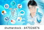chemist holding a test tube in... | Shutterstock . vector #647026876