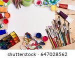 paints  brushes and palette on... | Shutterstock . vector #647028562