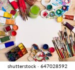 paints  brushes and palette on... | Shutterstock . vector #647028592