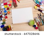 paints  brushes and palette on... | Shutterstock . vector #647028646