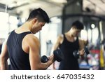 young man workout at gym | Shutterstock . vector #647035432