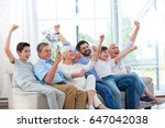 excited family watching... | Shutterstock . vector #647042038