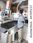 carpenter in workshop | Shutterstock . vector #64705117