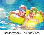 kid in swimming pool. | Shutterstock . vector #647059426