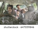 happy family travelling in car   | Shutterstock . vector #647059846