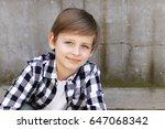 cute blonde boy in casual... | Shutterstock . vector #647068342