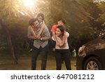 mother and father carrying... | Shutterstock . vector #647081212