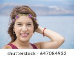 happy woman with wreath on her... | Shutterstock . vector #647084932