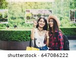 young women pointing at... | Shutterstock . vector #647086222