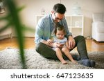 single father wit his daughter... | Shutterstock . vector #647123635