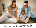 family lying on the floor with...   Shutterstock . vector #647123698