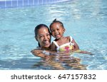 little girl swims with her mom | Shutterstock . vector #647157832