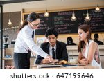Small photo of Woman waiter explain menu for customer