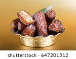 palm dates on the golden plate  ... | Shutterstock . vector #647201512
