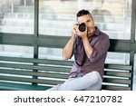 male photographer taking picture   Shutterstock . vector #647210782