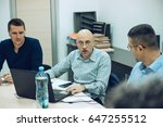 businessmen in a meeting talking | Shutterstock . vector #647255512