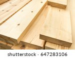 Small photo of Piled lumber near a lumber mill, waiting for shipping. Wood Mill. Lumber and wood slice.
