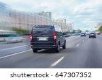 Black Minivan Is Moving On The...