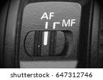 Small photo of Lens autofocus button, close up, selective focus with shallow depth of field.