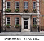 brick townhouse with flower... | Shutterstock . vector #647331562