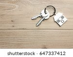 house shaped key in the wood | Shutterstock . vector #647337412