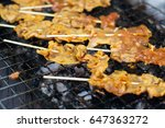 barbecue pork on grills | Shutterstock . vector #647363272