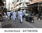 Small photo of Mumbai, India - October 11, 2015: Dawoodi Bohra Muslim people wearing traditional dresses walking to the mosque during Ramadan holy month at Chor Bazaar thief market