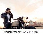 handsome rider guy with beard... | Shutterstock . vector #647414302