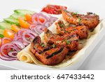 grilled lamb tongues with fresh ... | Shutterstock . vector #647433442