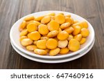 salted lupins on white plate | Shutterstock . vector #647460916