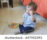 little boy sitting on the floor ... | Shutterstock . vector #647552392