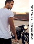 sporty biker handsome rider guy ... | Shutterstock . vector #647571682