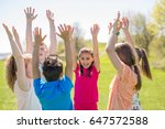 boys and girls with hand high... | Shutterstock . vector #647572588