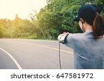 women running on the road for... | Shutterstock . vector #647581972