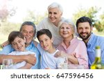 family sitting at table... | Shutterstock . vector #647596456